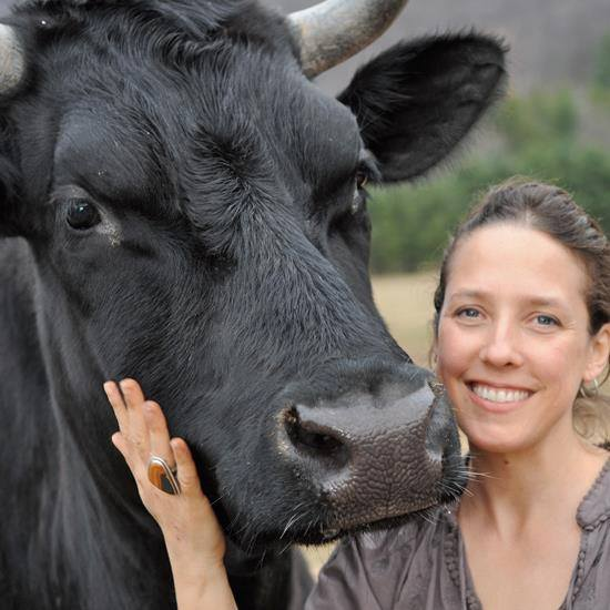 Jenny and Ralphie who was rescued as a veal calf. Photo © Woodstock Farm Animal Sanctuary.