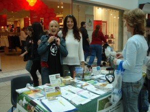 Di and Bella volunteering at Elated's information table. Photo © Karen Johnson - The Elated Vegan.
