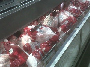 There must have been over 80 dressed turkeys in the frozen goods section of this supermarket. Being January, most of them will be thrown away. They will truly have died for nothing. Photo © Karen Johnson - The Elated Vegan
