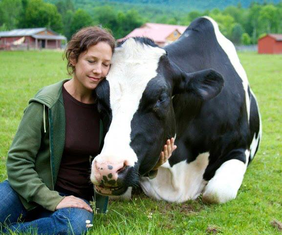 """I can't think if anything that makes me happier than seeing an animal's contentment, witnessing a creature allowed to be who he wants to be in the world — and at peace. It's a thing of beauty."" Jenny Brown and Dylan © Woodstock Farm Animal Sanctuary."