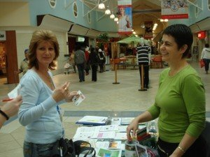 Discussing a vegan lifestyle at the Elated information table. Photo © Karen Johnson - The Elated Vegan.