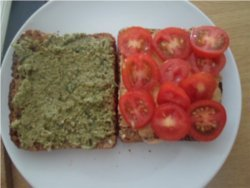 Spread your vegan basil pesto and red pepper butter bean dip on your sandwich.