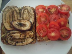 Arrange your roast eggplant and sliced tomatoes on your sandwich.