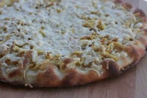Smoked tofu pizza in the style of Pizza alla Pugliese