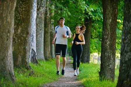 Exercise is a great way to nurture yourself. Go jogging with a friend in a beautiful setting to enhance the benefits. Photo © 123RF Benis Arapovic.